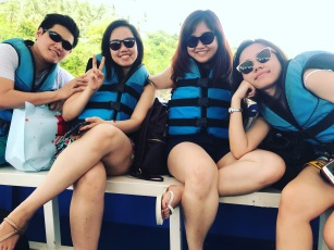 My siblings and my cousin on the boat